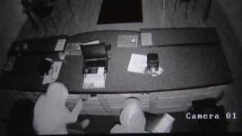 Surveillance image of the burglars in action (credit: CBS)